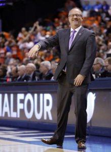 Washington head coach Mike Neighbors smiles during the first half of a national semifinal game against Syracuse, at the women's Final Four in the NCAA college basketball tournament Sunday, April 3, 2016, in Indianapolis. Photo by AJ Mast/AP.