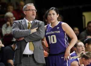 Mike Neighbors and Kelsey Plum discuss game strategy. Photo by Marcio Jose Sanchez/AP.
