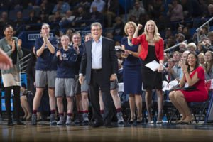 Connecticut coach Geno Auriemma and his assistant coaches look on after the Huskies tied their own record for consecutive wins. Photo by Stephen Slade.