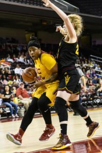 Kristen Simon drives to the bucket against Quinn Dornstauder. Photo by Percy Anderson.