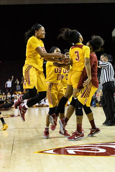 The Trojans celebrate their upset win over Arizona State. Photo by Percy Anderson.
