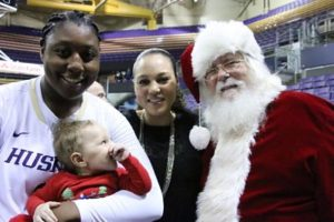 Chantel Osahor, Adia Barnes and Matteo with Santa Claus after a Husky home game in December, 2015. Photo by Adia Barnes.