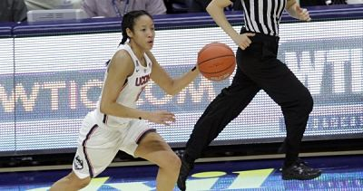 UConn's Saniya Chong pushes the ball upcourt. Chong leads the nation in assist/turnover ratio. Photo by Stephen Slade.