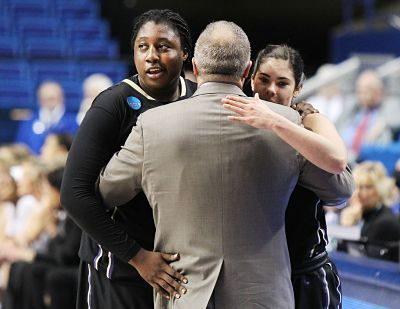 Mike Neighbors hugs Chantel Osahor and Kelsey Plum last March after their regional final win. AP Photo/James Crisp.