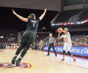 Courtney Jaco shoots over Hannah Johnson. Photo by Jaleesa Collins/T.G.Sportstv1.