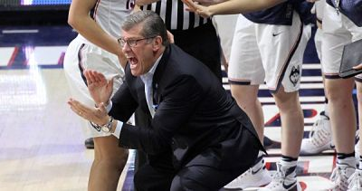 Geno Auriemma shouts encouragement to his UConn Huskies. Photo by Steve Slade.
