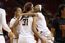 Mi'Cole Cayton hugs Kristine Anigwe at game's end. Photo by Cal.ISIPhotos.com.