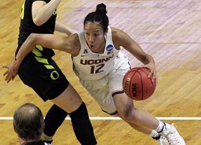 Saniya Chong drives to the basket. Photo by Steve Slade.