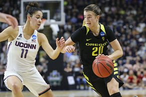 Sabrina Ionescu drives against Kia Nurse. Photo by Eric Evans Photography/Oregon Athletics.
