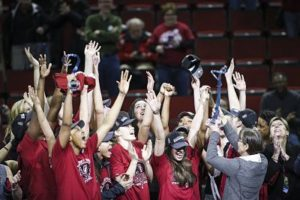 Coach Tara VanDerveer hoists the Pac-12 Tournament trophy. Photo by Eric Evans.