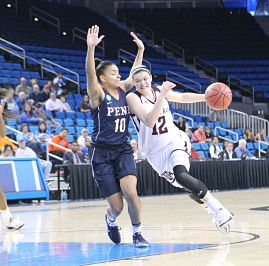 Danni Williams drives on Anna Ross. Photo by Benita West/TGTVSports1.
