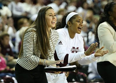 Carly Thibault and Victoria Vivians cheer on the Bulldogs during a February win. Photo by Kelly Price/MSU Media Relations.