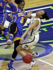 UCLA's Jordin Canada fouls Saniya Chong. Photo by Steve Slade.
