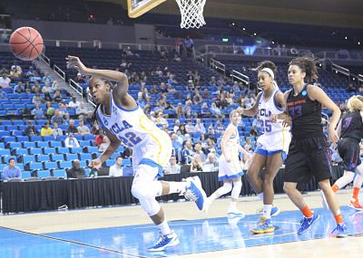 Kennedy Burke saves the ball for UCLA. She finished with 14 points and 10 rebounds. Photo by Benita West/TGTVSports1.