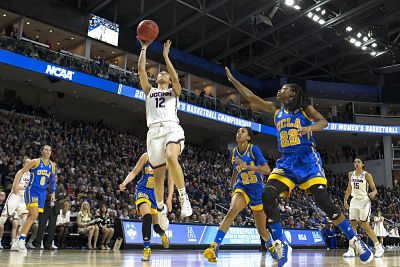 Saniya Chong goes up for two against UCLA. Photo courtesy of Connecticut Athletics.