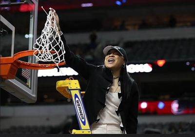 Dawn Staley cuts down the net Sunday after South Carolina's National Championship win. Photo courtesy of Gamecock Athletics.