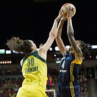 Breanna Stewart deflects a shot by Candice Dupree. Photo by Neil Enns/Storm Photos.