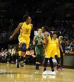 Nneka Ogwumike exults with Chelsea Gray after a shot. Photo by Maria Noble/Women's Hoops World.