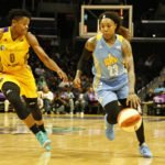 Cappie Pondexter pushes the ball up court as Alana Beard defends. Photo by Maria Noble, WomensHoopsWorld.