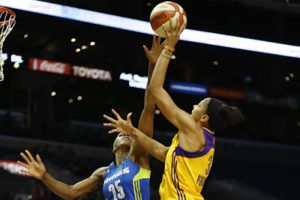 Glory Johnson tries to block Candace Parker's shot. Photo by Maria Noble/WomensHoopsWorld.