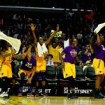 The Los Angeles Sparks celebrate their 90-59 win over the Phoenix Mercury. Photo by Maria Noble/WomensHoopsWorld.