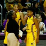 Sparks athletic trainer Courtney Watkins checks out Alana Beard's head. Photo by Maria Noble/WomensHoopsWorld.