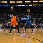 Maya Moore looks to pass the ball by Shekinna Stricklen. Photo by Brian Few Jr./T.G.Sportstv1.