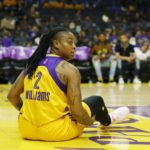 Riquna Williams prepares to get back on her feet after a foul. Photo by Maria Noble/WomensHoopsWorld.
