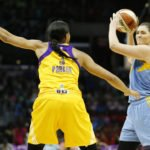 Stefanie Dolson swings the ball as Candace Parker guards her. Photo by Maria Noble/WomensHoopsWorld.