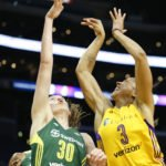 Breanna Stewart shoots over Candace Parker. Photo by Maria Noble/WomensHoopsWorld.