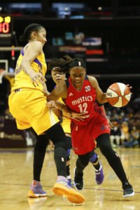 Ivory Latta slices past Candace Parker. Photo by Maria Noble/WomensHoopsWorld.