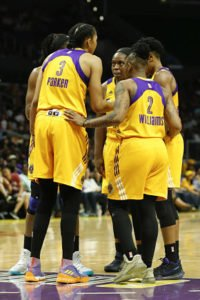 The Sparks speak at a timeout. Photo by Maria Noble/WomensHoopsWorld.