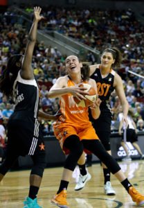 Western Conference's Seattle Storm's Breanna Stewart, center, prepares to shoot between Eastern Conference's New York Liberty's Sugar Rogers, left, and Chicago Sky's Stefanie Dolson in the second half of the WNBA All-Star basketball game Saturday, July 22, 2017, in Seattle. AP Photo/Elaine Thompson.