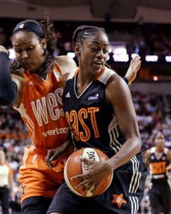 Western Conference's Maya Moore, left, of the Minnesota Lynx, tries to avoid running into Eastern Conference's Tiffany Hayes, of the Atlanta Dream, during the second half of the WNBA All-Star basketball game Saturday, July 22, 2017, in Seattle. The West won p130-121. AP Photo/Elaine Thompson.