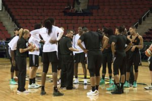 The East team huddles during the practice session. Photo by Jamie Mitchell/TGTVsports1.