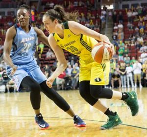 Breanna Stewart drives around the Dream's Sancho Lyttle. Photo by Neil Enns/Storm Photos.