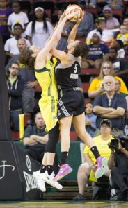 Breanna Stewart blocks Dearica Hamby's shot.  Photo by Neil Enns/Storm Photos.