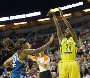 Jewell Loyd shoots over Seimone Augustus. Photo by Neil Enns/Storm Photos.