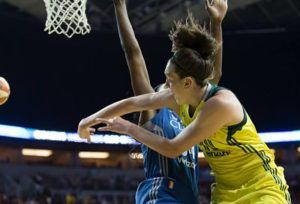 Breanna Stewart passes around Sylvia Fowles. Photo by Neil Enns/Storm Photos.
