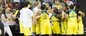 The Storm and Sue Bird, left, celebrate after beating the WNBA-best Lynx. Photo by Neil Enns/Storm Photos.