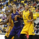 Brittney Griner and Candace Parker look for the rebound. Photo by Maria Noble/WomensHoopsWorld.
