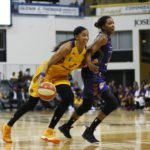Candace Parker pushes up court. Photo by Maria Noble/WomensHoopsWorld.