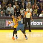 Candace Parker battles to pass around Maya Moore. Photo by Benita West/TGSportsTV1.
