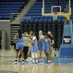 Teams huddle during a scrimmage. Photo by Maria Noble/WomensHoopsWorld.
