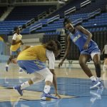 Jordin Canada and Kayla Owens hit the baseline. Photo by Maria Noble/WomensHoopsWorld.