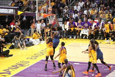 Sylvia Fowles elevated over Nneka Ogwumike to score. Photo by Benita West/TGSportsTV1.