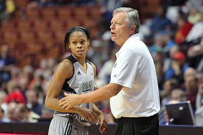 Dan Hughes consults with Moriah Jefferson during a 2016 preseason game. Photo by Tim Clayton/Corbis via Getty Images.