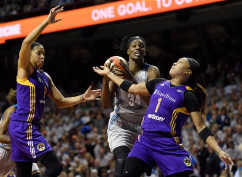 Sylvia Fowles rebounds against Candace Parker and Odyssey Sims. Photo by Hannah Foslien/NBAE via Getty Images.