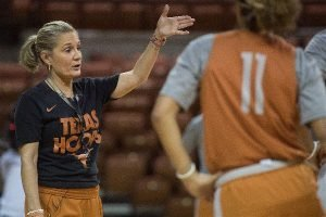 Coach Karen Aston makes a point at a break in play. Photo courtesy of Texas Athletics.