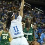 Dekeiya Cohen tries to muscle up past Lajahna Drummer. Photo by Maria Noble/WomensHoopsWorld.